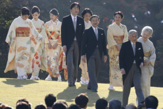 naruhito and Masako walk behind the Emperor and Empress during an annual autumn garden party in Tokyo in 2017.