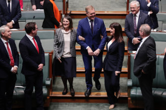 """Tony Smith is """"dragged"""" to the speaker's chair by Labor's Maria Vamvakinou and Liberal MP Lucy Wicks."""