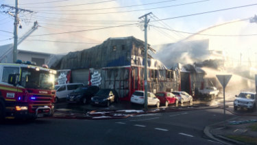 Surrounding streets remained closed throughout the morning as fire investigators examined the scene.