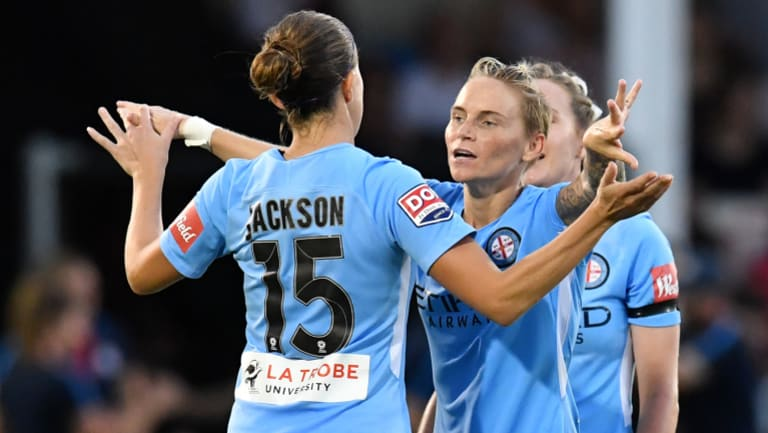 Melbourne City's Jess Fishlock (right) and Amy Jackson celebrate a goal against Brisbane Roar.