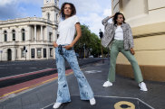 Flares and bootleg jeans make a return to street style. Models Valerie Wetmore and Natalia Loaiza wearing One Teaspoon.