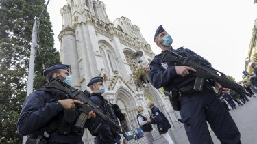 Police officers stand guard near Notre-Dame Cathedral in Nice.