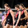 Essendon players take in their loss to Geelong on Sunday.