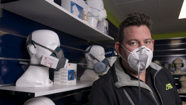Director of Onsite Safety Australia, Chris Bellamy, demonstrating testing of a faulty face mask.