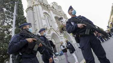 Police officers stand guard near Notre-Dame Basilica in Nice following the fatal attack in October.