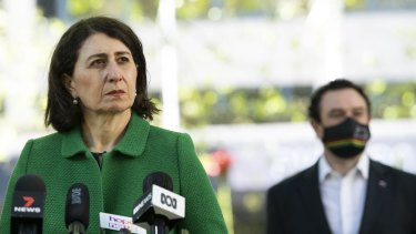 NSW Premier Gladys Berejiklian and Tourism Minister Stuart Ayres on Friday. Ayres expects Local Government Areas will no longer be used to mark boundaries of concern once a 70 per cent vaccination is achieved.
