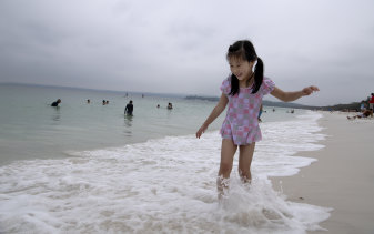 Yuhan Gao, from Shanghai, enjoys the waters of Hyams Beach on Monday.