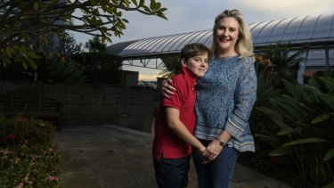 """Senator Hollie Hughes, with son Fred who has autism, said the independent assessment trialled uses a """"tick-a-box algorithm""""."""
