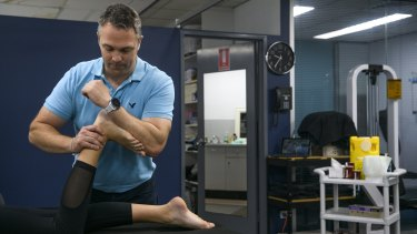 Physiotherapist Tom Sheehan with a patient at Northside Sports Physiotherapy.