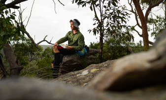 Tristan White, 27, the communications officer of NSW Rogaining, pictured in the Berowra Valley National Park in Sydney.