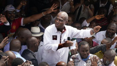 Defeated Congo opposition candidate Martin Fayulu greets supporters as he arrives at a rally in Kinshasha, Congo, on Friday. He is challenging the election result.