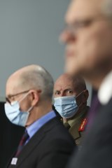 Chief Medical Officer Professor Paul Kelly, COVID-19 Taskforce Commander, Lieutenant General John Frewen and Prime Minister Scott Morrison at Parliament House on Friday.