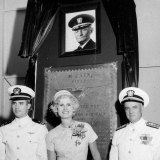 In this July 14, 1961, file photo, US Navy Lieutenant Commander John S McCain III, left, and his parents, Rear Admiral John S McCain Jr, right, and Roberta Wright McCain stand in front of a plaque with an image of his grandfather, Admiral John S McCain, at the Naval Air Station Meridian McCain Field in Mississippi.