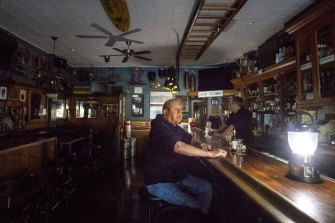 Joseph Pokorski drinks a beer at The Town Square as downtown Sonoma remains without power.