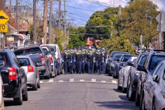 Police close off a suburban street in Melbourne's inner-east.