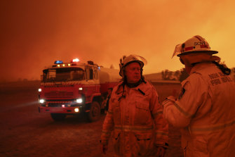 RFS firefighters getting ready to defend properties in Bumbalong on Saturday.