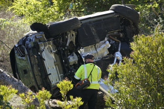 Investigators at the scene of Tiger Woods' car crash in Los Angeles.