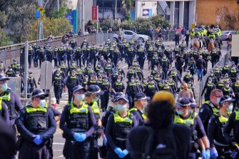 Police in Richmond during a large anti-lockdown protest in September.