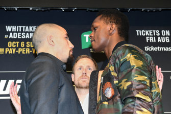 Battle lines drawn: Israel Adesanya (right) faces off with Robert Whittaker (left).