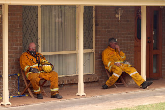 Firefighters take a well-earned break on Friday.