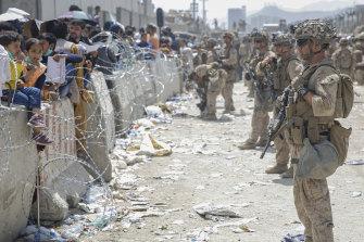 US troops line the airport perimeter at Hamid Karzai International Airport in Kabul.