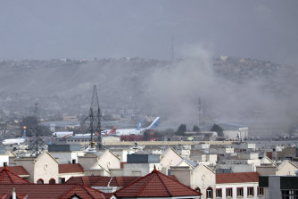 Smoke rises from an explosion outside Kabul airport on Thursday.