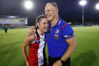 No hard feelings: Alice and Nathan Burke embrace after the game.