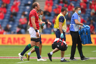 Lions captain Alun Wyn Jones is led from the field by medics after injurying his shoulder.