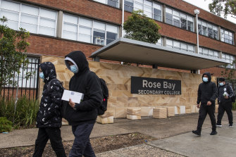 Cleaners arrive at Rose Bay Secondary College in Dover Heights on Tuesday after a student tested positive to COVID-19.
