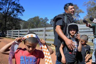 AJ's father, Anthony Elfalak, with his other sons on their property in Putty after his son was found.
