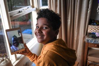 Ndahmowa, 9, talks to relatives on FaceTime.