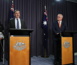 The PM at the press conference announcing the vaccine changes
