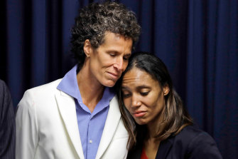Bill Cosby accuser Andrea Constand, left, embraces prosecutor Kristen Feden during a news conference after Cosby was found guilty in his sexual assault retrial in 2018.