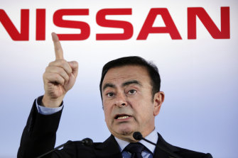 Then Nissan president and CEO Carlos Ghosn speak during a press conference in Yokohama, near Tokyo, in 2012.