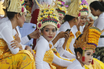 Balinese dancers wearing traditional dress at the Kuningan festival.  Indonesia had not previously detected any cases of coronavirus.