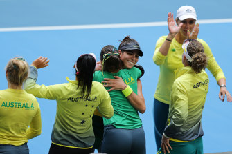 Tomljanovic is congratulated by her teammates after winning her singles match to keep the team's Fed Cup hopes alive.