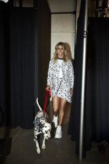 A model backstage with Richard the dalmatian at the Nana Judy show in New York.