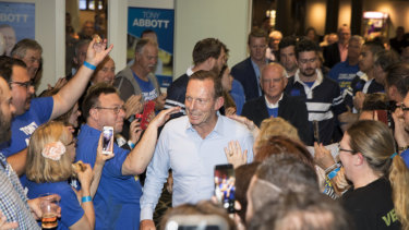 Supporters commiserate with Tony Abbott at Manly Leagues Club on election night.