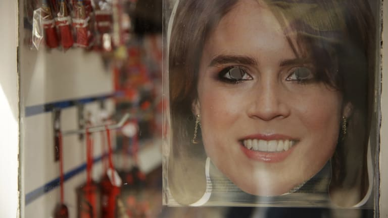 A Princess Eugenie mask for sale in the window of a souvenir shop in Windsor on Wednesday.