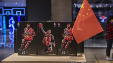 A Chinese flag placed alongside NBA merchandise in Beijing.