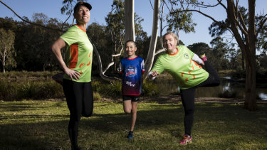 Sue White, Adam Ching and Jeanne-Vida Douglas stretch after running at the Westies Joggers Clubhouse at Mirambeena Reserve in Sydney.