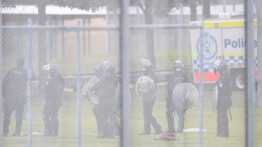 Riot squad set to move in as detention centre inmates refuse to leave roof
