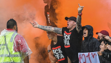 Tensions flare: The Red and Black Bloc react after an Oriol Riera goal for Wanderers against Sydney FC in the derby.