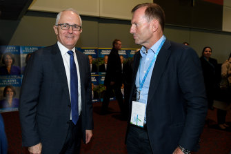 Malcolm Turnbull and Tony Abbott cross paths at a Liberal Party convention in 2017.