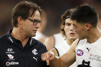 Blues coach David Teague speaks with Nic Newman during their side's clash with the Demons.