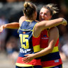 Danielle Ponter and Ebony Marinoff of the Adelaide Crows celebrate.