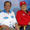 Former Malaysian foes side by side for first time in decades