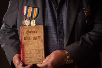 Malcolm Milliken, holds his uncle Morris Milliken's World War I diary.