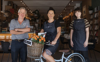 Ray Bonner and employees Manea, middle, and Jess, of Sydney's Bookoccino, are home delivering books to people who don't want to venture out during the coronavirus pandemic.