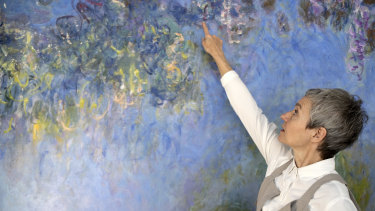 Ruth Hoppe, the modern art conservator at the Gemeentemuseum, with a painting of wisteria by Monet in The Hague, May 24, 2019. After Hoppe X-rayed the work, she  found that another painting of water lilies was underneath.